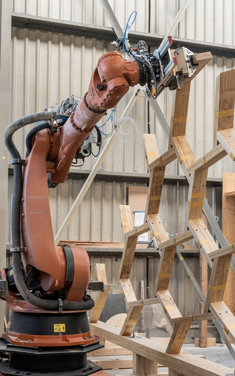 Every timber element is cut to size and placed by a robot.