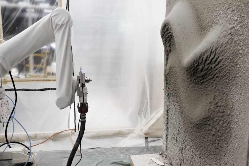 RPS (Robotic Plaster Spraying) process building up a volumetric formation, with adaptive thin-layer printing on a vertical surface.